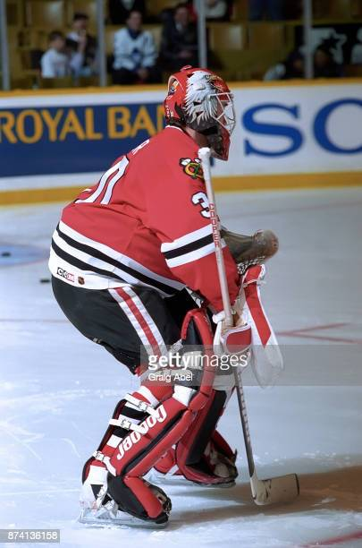 Ed Belfour of the Chicago Black Hawks skates against the Toronto Maple Leafs on April 3 1996 at Maple Leaf Gardens in Toronto Ontario Canada