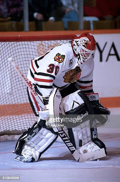 Ed Belfour of the Chicago Black Hawks stops a shot against the Toronto Maple Leafs during game action on February 29 1992 at Maple Leaf Gardens in...