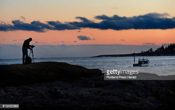 Ed Brown of Gorham sets up a tripod to photograph the sunset at Kettle Cove State Park in Cape Elizabeth Tuesday February 6 2018