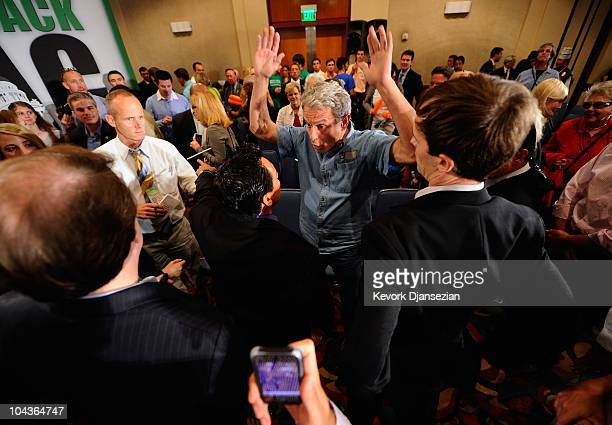 Ed Buck is confronted by security after disrupting California Republican Party gubernatorial candidate Meg Whitman's campaign event on September 22...