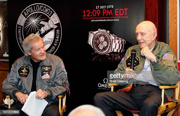 Ed Buckbee and Tom Stafford attend a presentation of a lunar rover Apollo 10 space suit and Mars rover along with Speedmaster mission watches from...