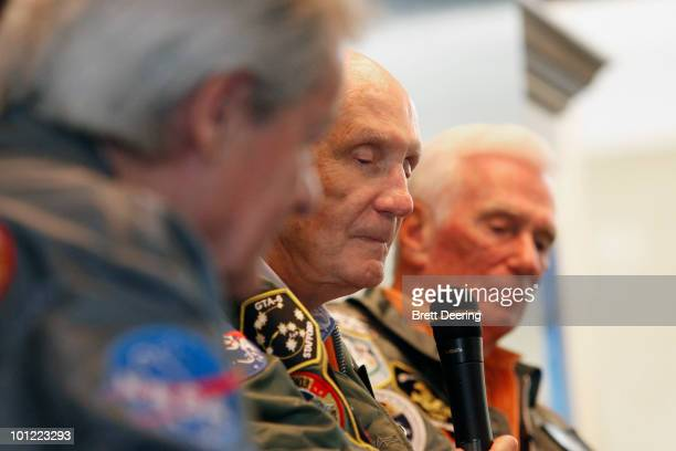 Ed Buckbee Tom Stafford and Gene Cernan speak at a presentation of a lunar rover Apollo 10 space suit and Mars rover along with Speedmaster mission...