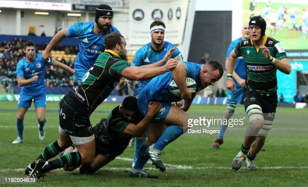 Ed Byrne of Leinster dives over for the final try during the Heineken Champions Cup Round 3 match between Northampton Saints and Leinster Rugby at...