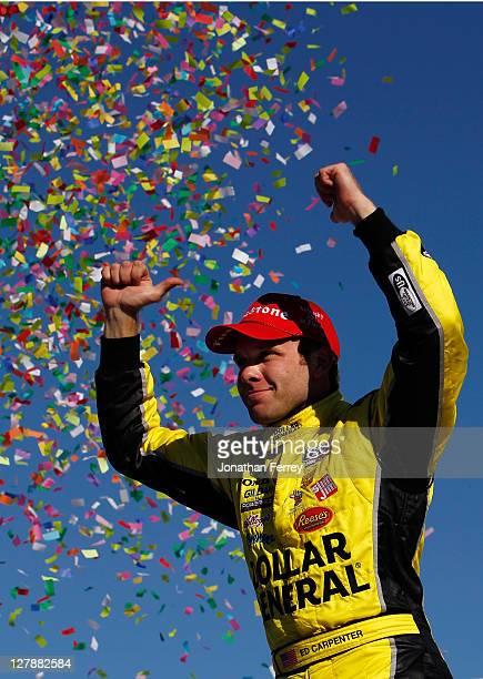 Ed Carpenter driver of Dollar General Sarah Fisher Racing Dallara Honda celebrates winning the IZOD IndyCar Series Kentucky Indy 300 on October 2...