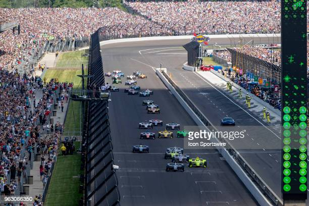 Ed Carpenter driver of the Ed Carpenter Racing Chevrolet and the rest of the field takes the green flag to start the running of the 102nd...