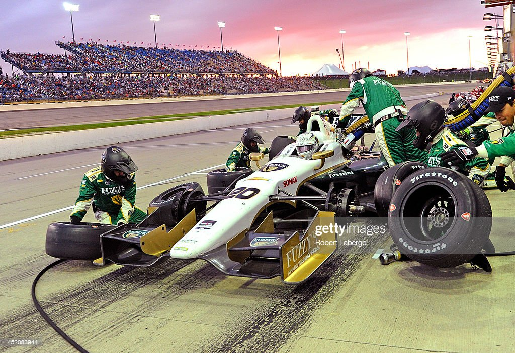 Ed Carpenter driver of the #20 Ed Carpenter Racing Dallara Chevrolet makes a pit stop during the Verizon IndyCar Series Iowa Corn Indy 300 presented by DEKALB at the Iowa Speedway on July 12, 2014 in Newton, Iowa.