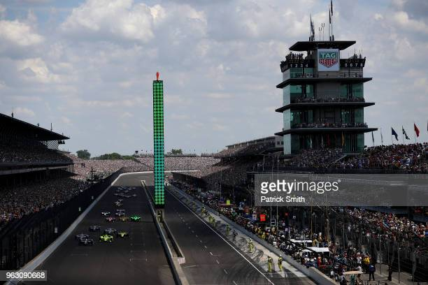 Ed Carpenter driver of the Ed Carpenter Racing Fuzzy's Vodka Chevrolet leads the fields for the start of the 102nd Indianapolis 500 at Indianapolis...