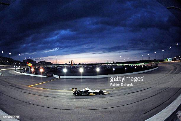 Ed Carpenter driver of the Fuzzy's Vodka/Ed Carpenter Racing Dallara Chevrolet races during the Iowa Corn Indy 300 at Iowa Speedway on July 12 2014...