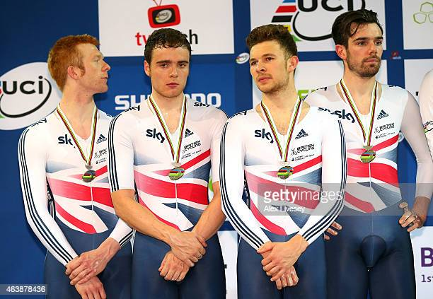 Ed Clancy Steven Burke Owain Doull and Andrew Tennant of the Great Britain Cycling Team look on after receiving their silver medals after the Men's...