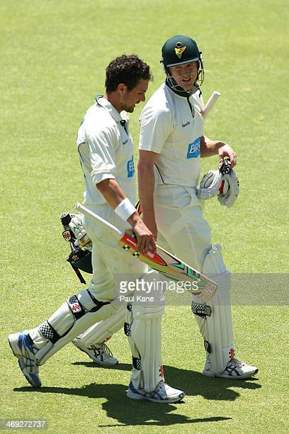 Ed Cowan and George Bailey of the Tigers walk from the field at lunch during day three of the Sheffield Shield match between the Western Australia...