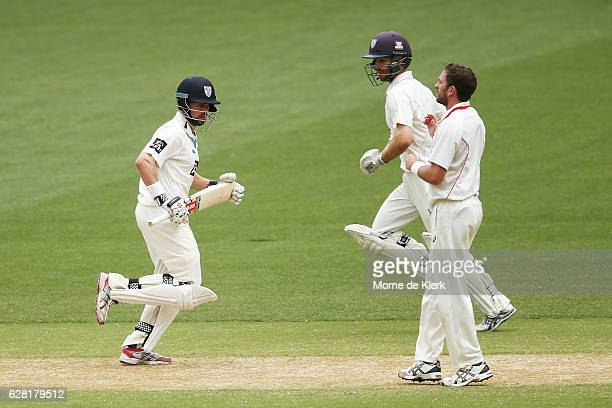 Ed Cowan and Ryan Carters of the NSW Blues run between the wickets during day three of the Sheffield Shield match between South Australia and New...