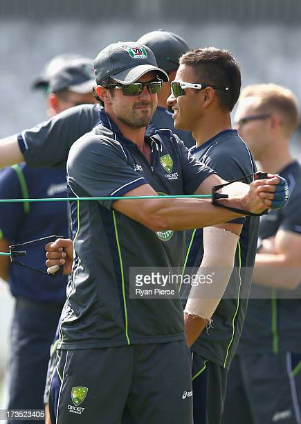 Ed Cowan of Australia and Usman Khawaja of Australia warm up during an Australian Nets Session at Lord's Cricket Ground on July 16 2013 in London...