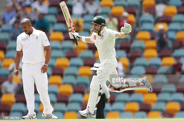 Ed Cowan of Australia celebrates his century during day four of the First Test match between Australia and South Africa at The Gabba on November 12...