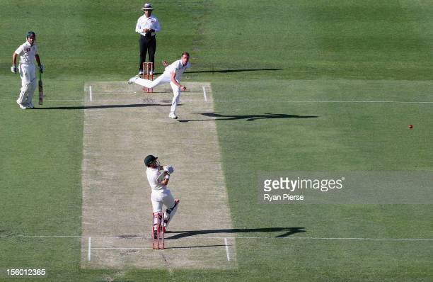 Ed Cowan of Australia plays a hook shot against Dale Steyn of South Africa during day three of the First Test match between Australia and South...
