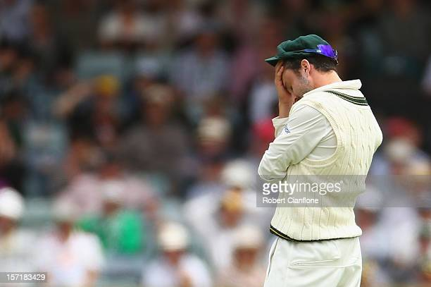 Ed Cowan of Australia reacts after he dropped a catch off Hashim Amla of South Africa during day one of the Third Test Match between Australia and...