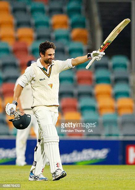 Ed Cowan of Tasmania celebrates scoring a century during day two of the Sheffield Shield match between Tasmania and Victoria at Blundstone Arena on...