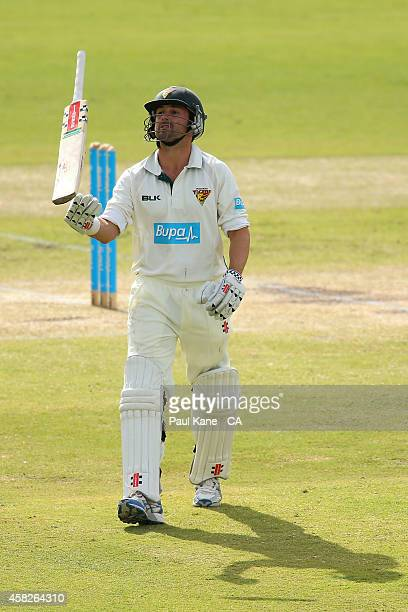 Ed Cowan of Tasmania throws his bat in the air after being dismissed during day three of the Sheffield Shield match between Western Australia and...