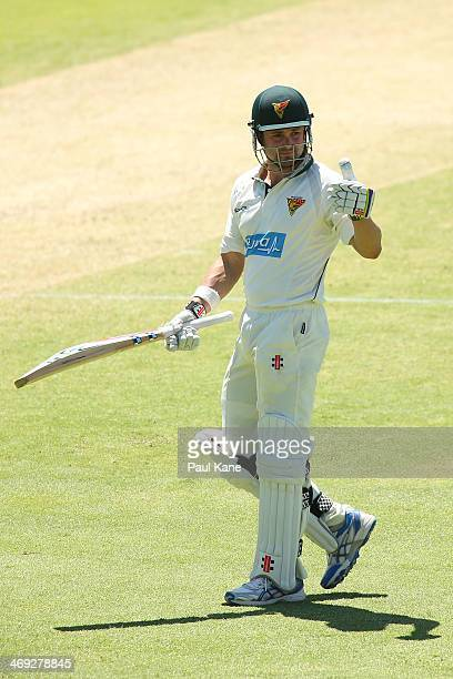 Ed Cowan of the Tigers acknowledges the rooms after reaching his half century during day three of the Sheffield Shield match between the Western...