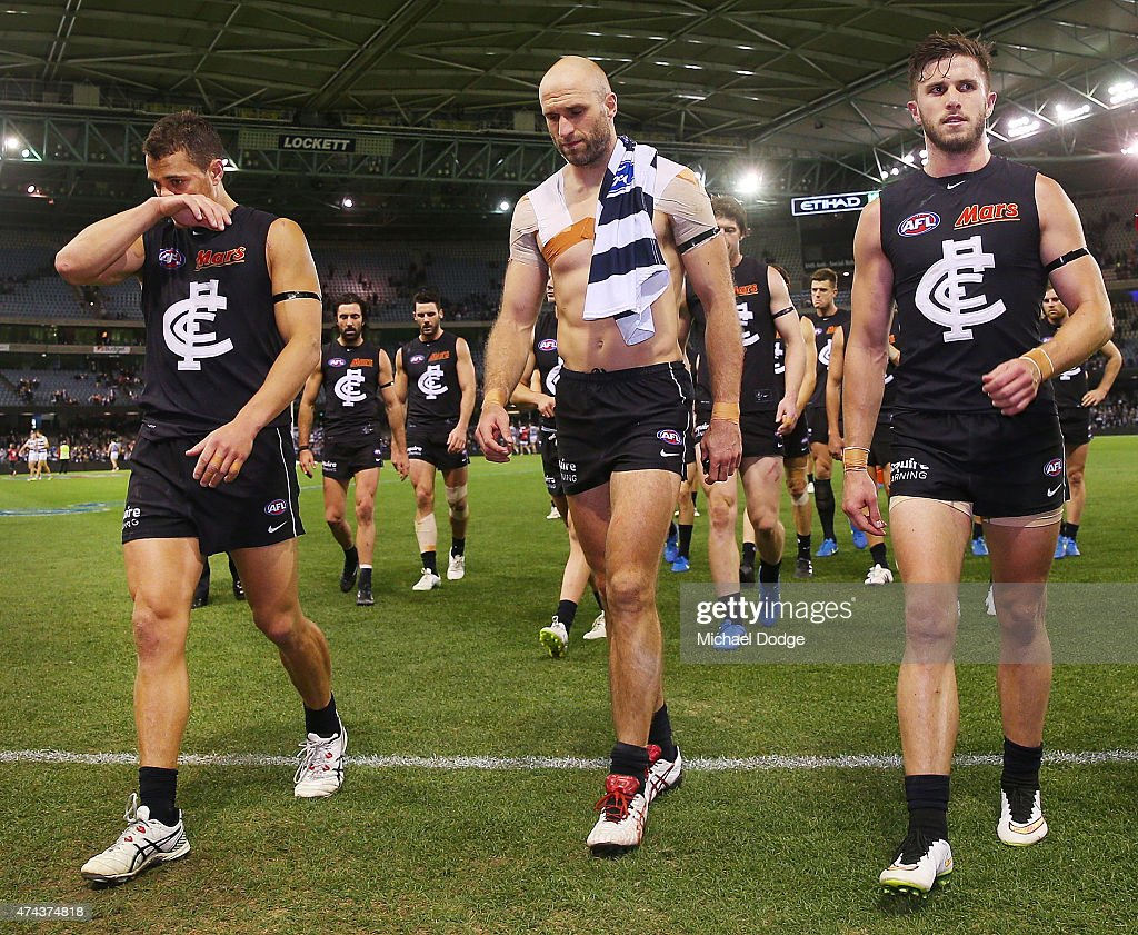 Ed Curnow (L) Marc Murphy (R) and Chris Judd of the Blues walks off after defeat with the jumper of Cameron Guthrie of the Cats during the round eight AFL match between the Geelong Cats and the Carlton Blues at Etihad Stadium on May 22, 2015 in Melbourne, Australia.