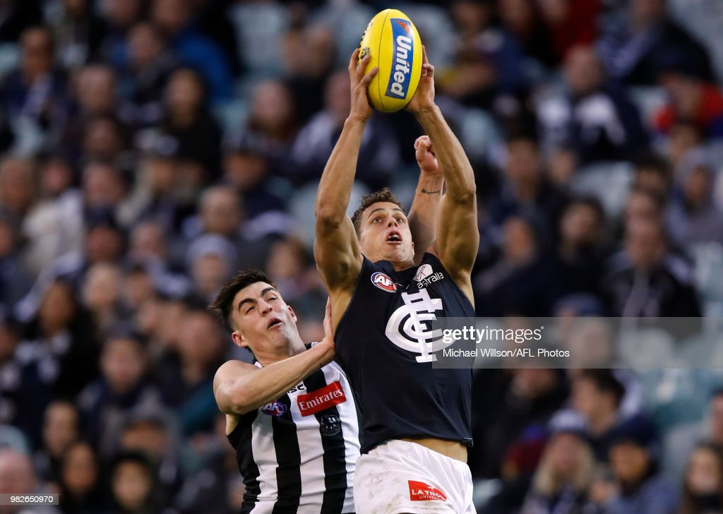 Ed Curnow of the Blues and Brayden Maynard of the Magpies compete for the ball during the 2018 AFL round 14 match between the Collingwood Magpies and the Carlton Blues at the Melbourne Cricket Ground on June 23, 2018 in Melbourne, Australia.