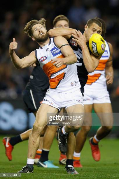 Ed Curnow of the Blues and Callan Ward of the Giants compete during the round 20 AFL match between the Carlton Blues and the Greater Western Sydney...