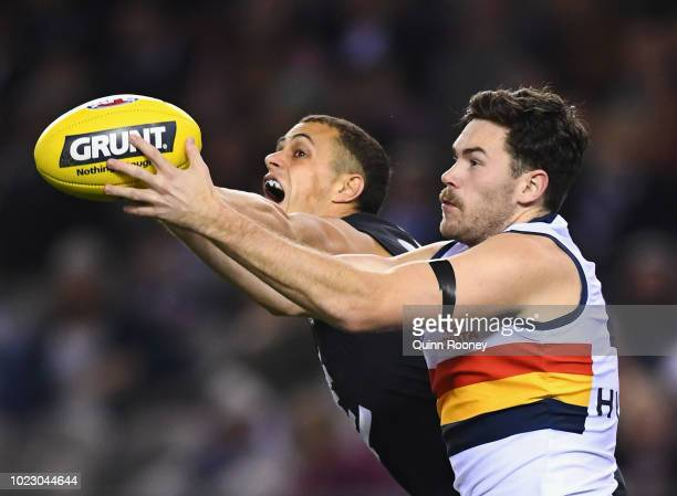 Ed Curnow of the Blues and Mitchell McGovern of the Crows compete for a mark during the round 23 AFL match between the Carlton Blues and the Adelaide...