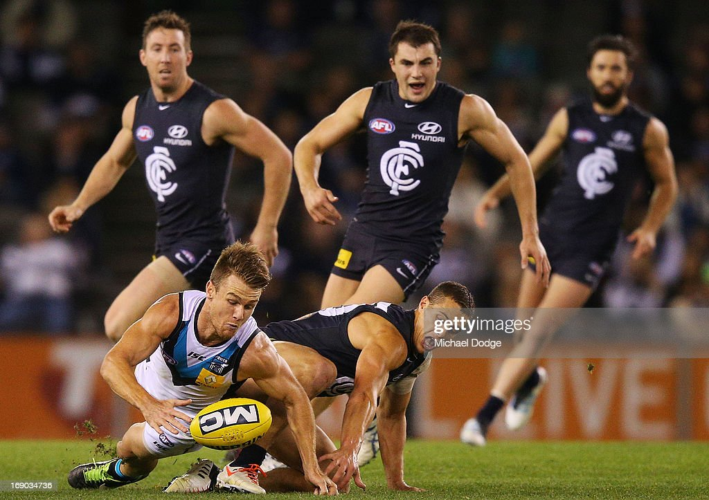 Ed Curnow of the Blues and Robbie Gray (R) of Port Adelaide contest for the ball during the round eight AFL match between the Carlton Blues and Port Adelaide Power at Etihad Stadium on May 19, 2013 in Melbourne, Australia.