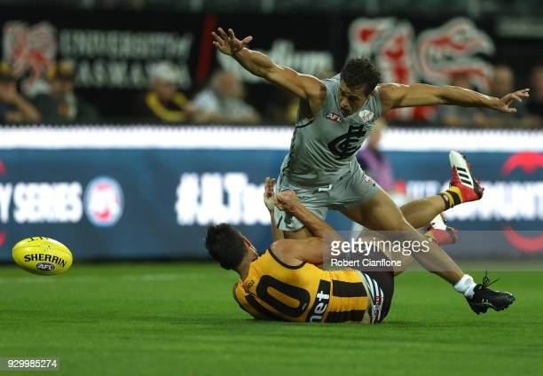 Ed Curnow of the Blues is challenged by Jaeger O'Meara of the Hawks during the JLT Community Series AFL match between the Hawthorn Hawks and the...