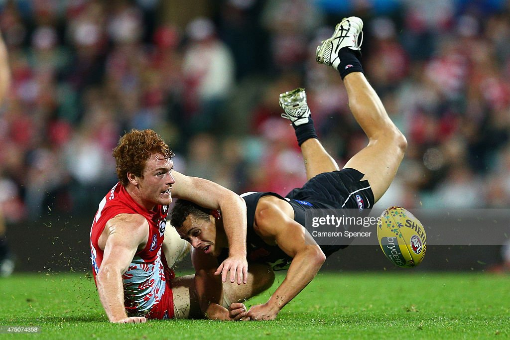 Ed Curnow of the Blues is tackled by Gary Rohan of the Swans during the round nine AFL match between the Sydney Swans and the Carlton Blues at SCG on May 29, 2015 in Sydney, Australia.