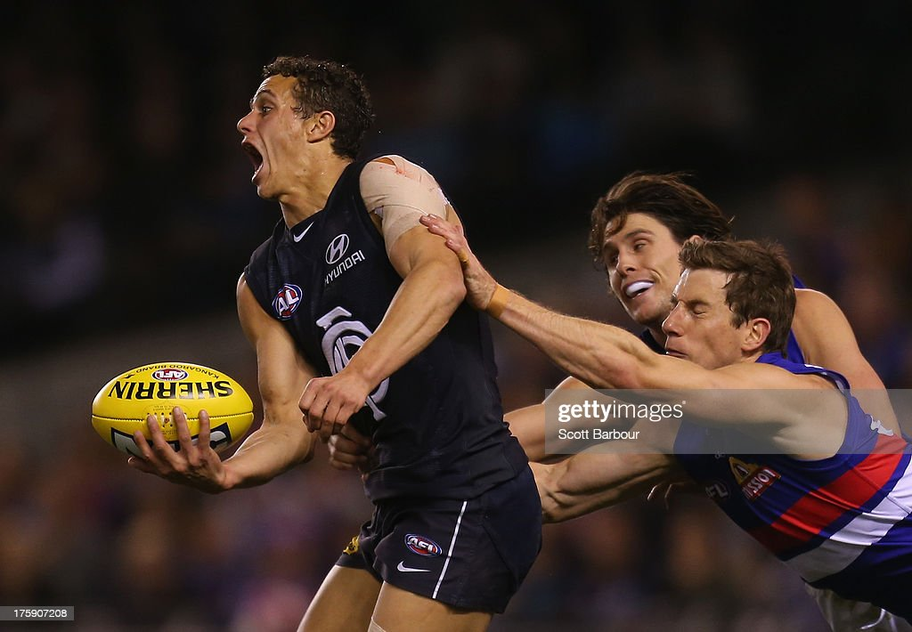 Ed Curnow of the Blues is tackled during the round 20 AFL match between the Carlton Blues and the Western Bulldogs at Etihad Stadium on August 10, 2013 in Melbourne, Australia.