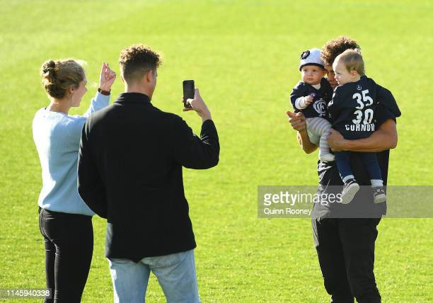 Ed Curnow of the Blues poses for a photo with his niece Lucinda and son Will Curnow ahead of his 150th game during a Carlton Blues AFL media...