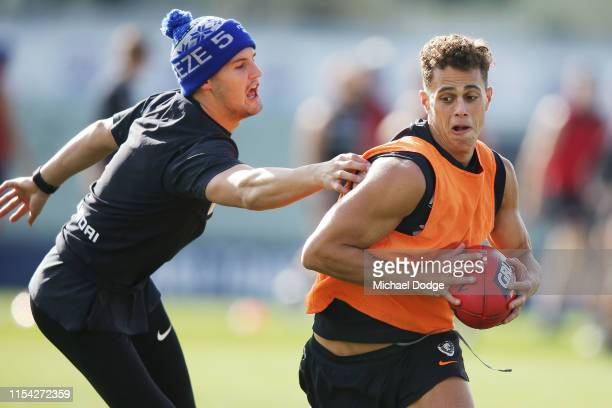 Ed Curnow of the Blues runs with the ball from Nic Newman of the Blues during a Carlton Blues AFL media opportunity at Ikon Park on June 07 2019 in...