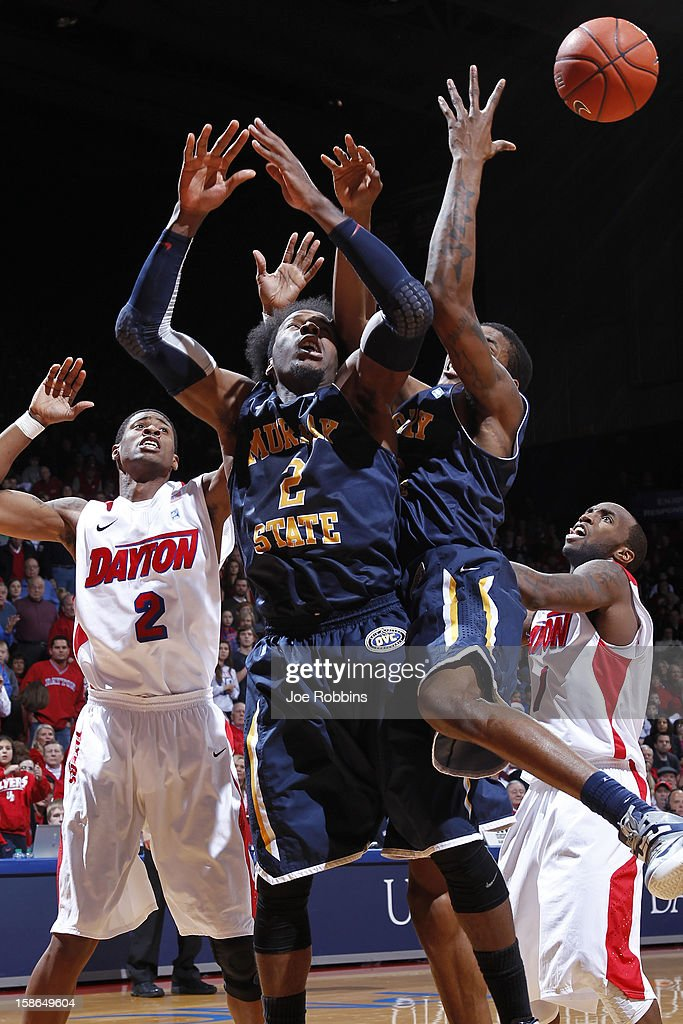 Ed Daniel #2 of the Murray State Racers loses the ball while trying to rebound against Kevin Dillard #1 and Josh Benson #2 of the Dayton Flyers during the game at University of Dayton Arena on December 22, 2012 in Dayton, Ohio. The Flyers won 77-68.