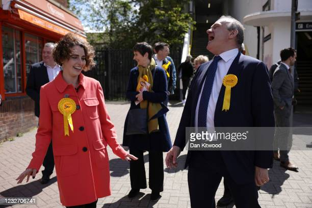 Ed Davey , Leader of the Liberal Democrats and Luisa Porritt, Liberal Democrat Mayoral Candidate laugh as they campaign in Surbiton on May 5, 2021 in...