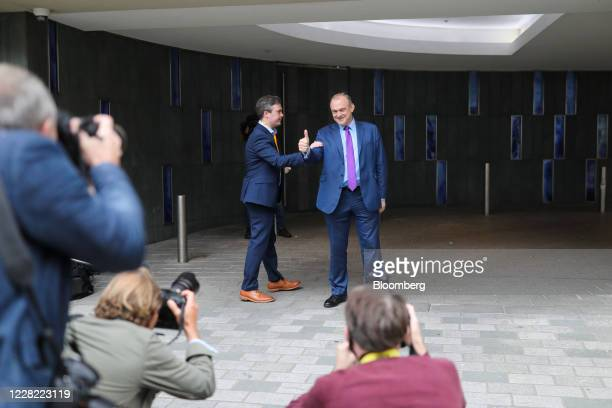 Ed Davey, leader of the Liberal Democrats, right, gestures following a news conference announcing his election as the new leader of the opposition...