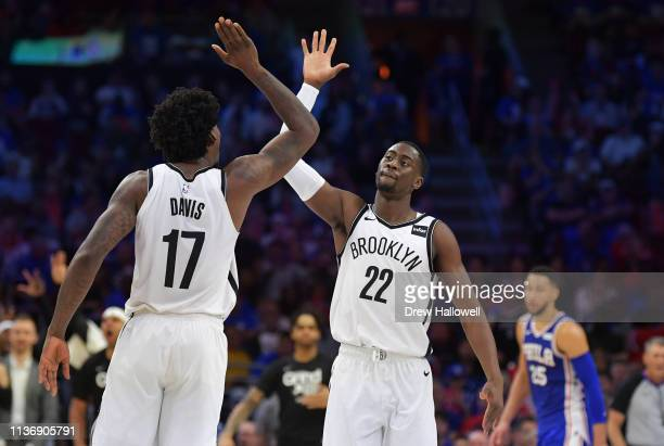 Ed Davis and Caris LeVert of the Brooklyn Nets celebrate against the Philadelphia 76ers in the second half during Game One of the first round of the...