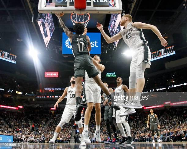 Ed Davis of the Brooklyn Nets scores next to Davis Bertans of the San Antonio Spurs at ATT Center on January 31 2019 in San Antonio Texas NOTE TO...
