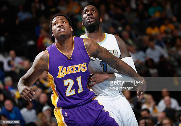 Ed Davis of the Los Angeles Lakers and JJ Hickson of the Denver Nuggets battle for rebounding position at Pepsi Center on April 8 2015 in Denver...
