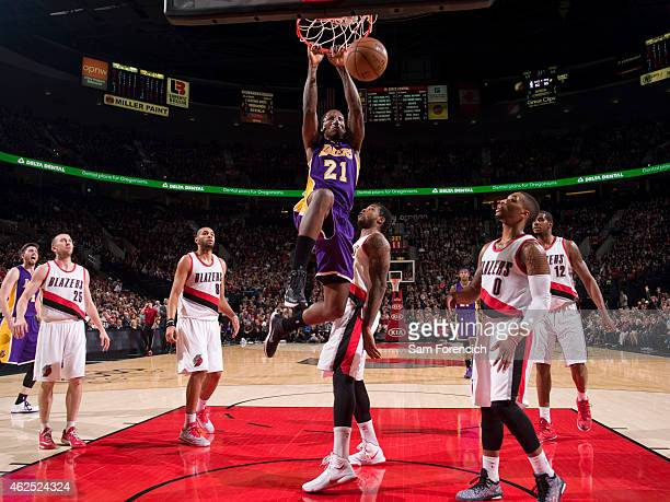 Ed Davis of the Los Angeles Lakers dunks the ball against the Portland Trail Blazers on January 5 2015 at the Moda Center Arena in Portland Oregon...