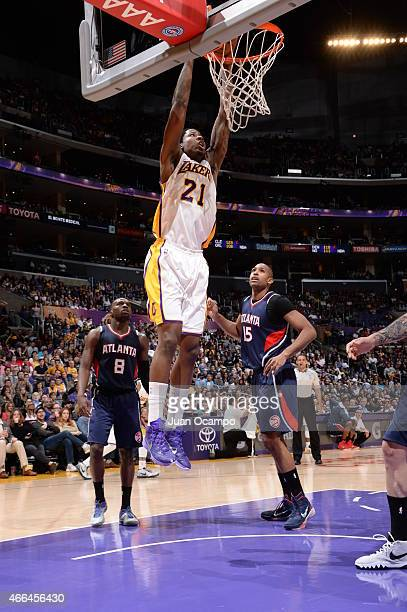 Ed Davis of the Los Angeles Lakers goes to the basket against the Atlanta Hawks on March 15 2015 at Staples Center in Los Angeles California NOTE TO...