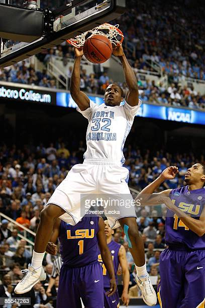 Ed Davis of the North Carolina Tar Heels dunks against Garrett Temple of the Louisiana State University Tigers during the second round of the NCAA...