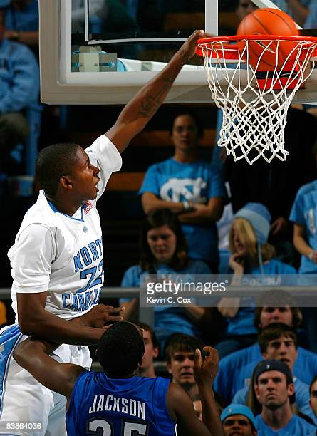 Ed Davis of the North Carolina Tar Heels dunks against Quinard Jackson of the UNC Asheville Bulldogs during the game at the Dean E. Smith Center on...