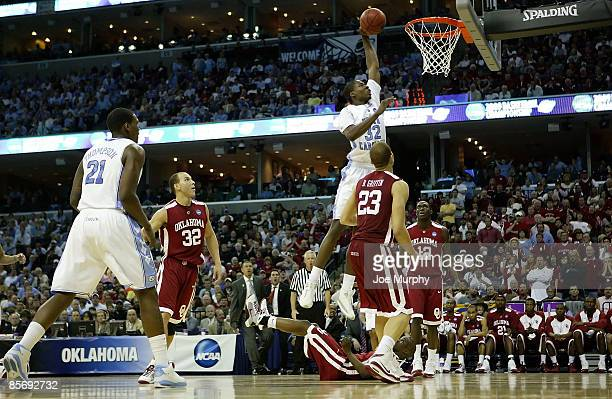 Ed Davis of the North Carolina Tar Heels goes up for a shot in the lane between three Oklahoma Sooners defenders in the first half during the NCAA...