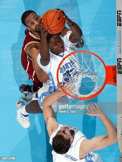 Ed Davis of the North Carolina Tar Heels goes up for the slam dunk attempt as Josh Southern of the Boston College Eagles looks on during their game...