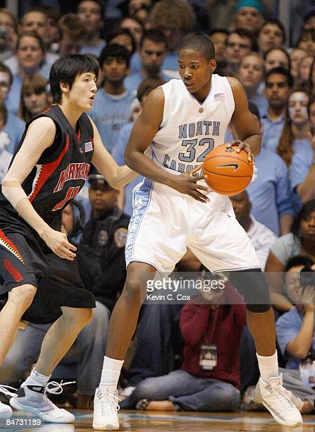 Ed Davis of the North Carolina Tar Heels looks to move the ball against Jin Soo Kim of Maryland Terrapins during the game on February 3 2009 at the...