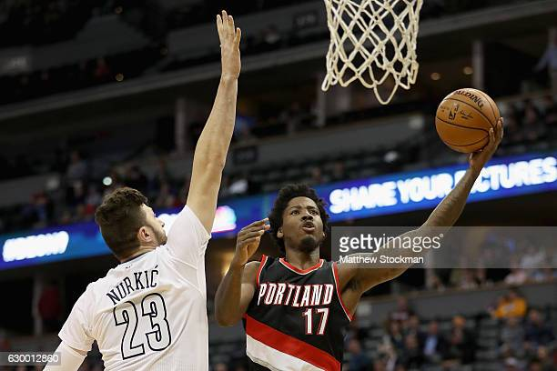 Ed Davis of the Portland Trail Blazers drives to the basket against Jusuf Nurkic of the Denver Nuggets at the Pepsi Center on December 15 2016 in...