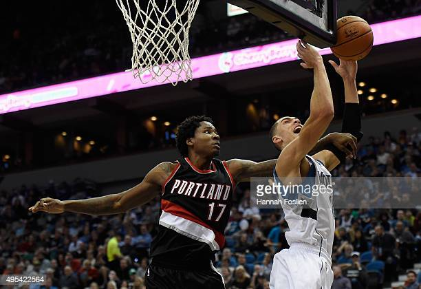 Ed Davis of the Portland Trail Blazers fouls Zach LaVine of the Minnesota Timberwolves during the third quarter of the home opening game on November...