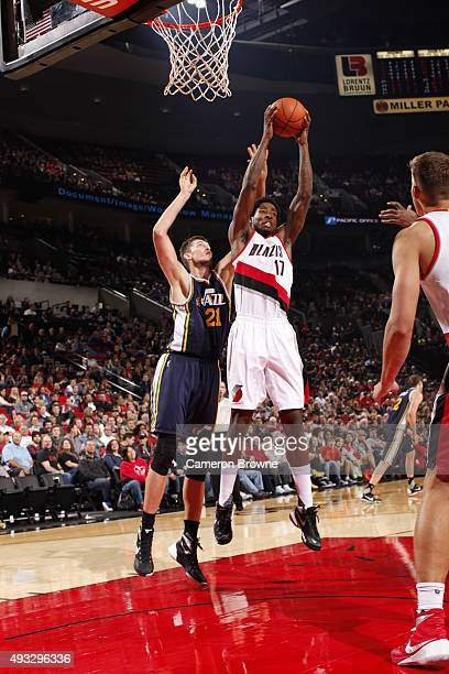 Ed Davis of the Portland Trail Blazers grabs the rebound against Tibor Pleiss of the Utah Jazz on October 18 2015 at the Moda Center in Portland...