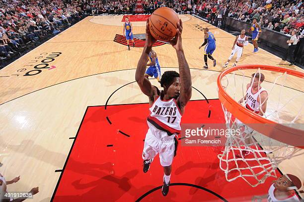Ed Davis of the Portland Trail Blazers grabs the rebound against the Golden State Warriors during a preseason game on October 8 2015 at the Moda...
