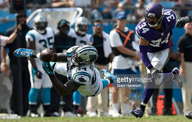 Ed Dickson of the Carolina Panthers dives for a catch against Andrew Sendejo of the Minnesota Vikings in the 3rd quarter during the game at Bank of...